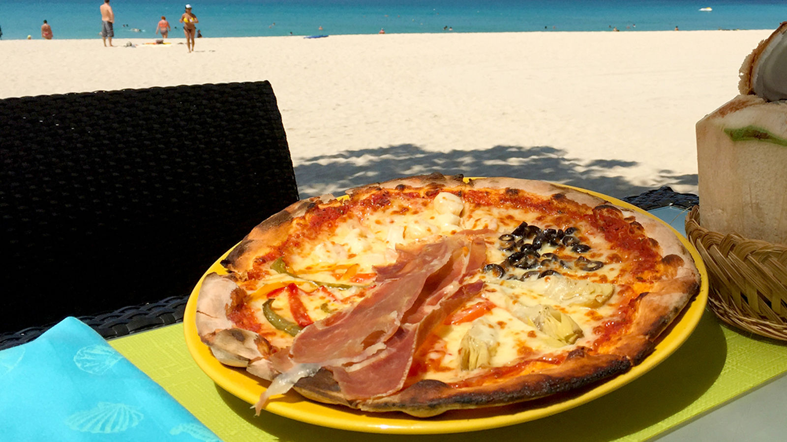Delicious Wood-fire Oven Cooked Pizzas by the Beach